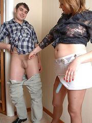 Filthy guy in sheer pantyhose dropping on his knees to suck gal's strap-on