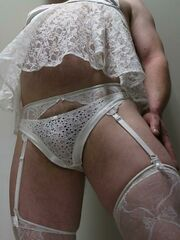 Crossdresser posing in beautiful lingerie series